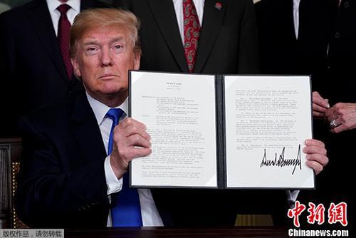 """当地时间2018年3月22日,美国总统特朗普在华盛顿签署总统备忘录,依据""""301调查""""结果,将对从中国进口的商品大规模征收关税,并限制中国企业对美投资并购。"""